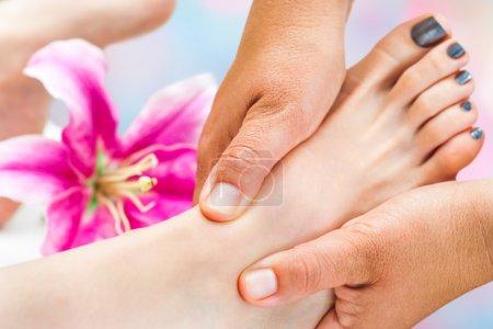 Reflexologist working on female foot
