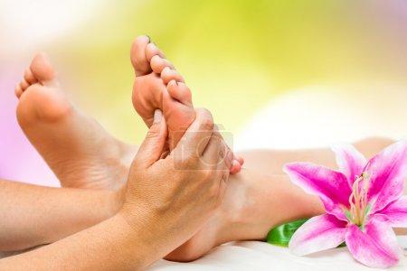Spa therapist doing foot massage