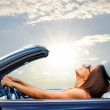 Portrait of Young girl driving cabriolet at sunset...