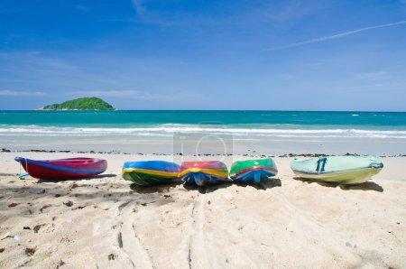 Colourful kayaks on the beach
