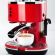 A red vintage looking espresso coffee machine is m...