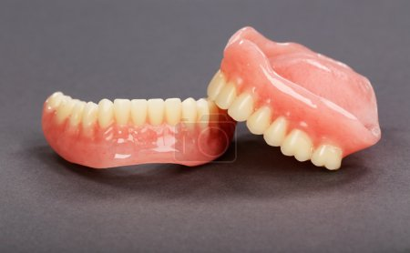 A set of dentures on a gray background...