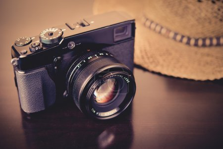 Photo for Modern camera with a vintage look ready for traveling - Royalty Free Image