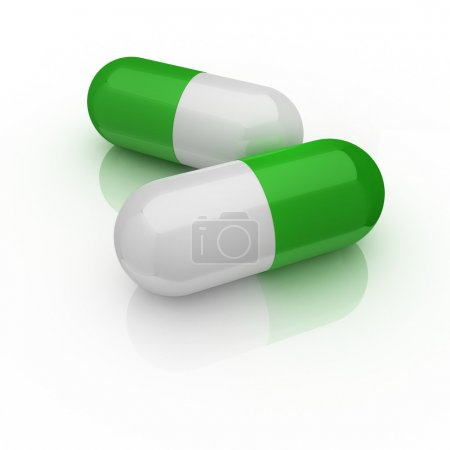 Two medical pills isolated on the white