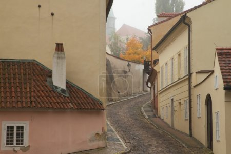 Foggy morning in an old streets of Prague.