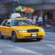 Yellow cab in New York street. Blurred background....