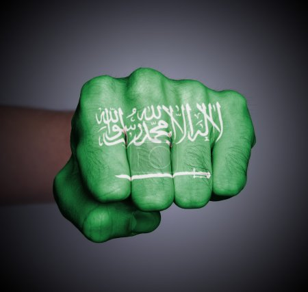 Photo for Front view of punching fist on gray background, flag of Saudi Arabia - Royalty Free Image