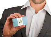 Businessman is holding a business card, Guatamala