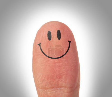 Female thumbs with smile face on the finger