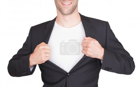Businessman opening suit to reveal a white shirt