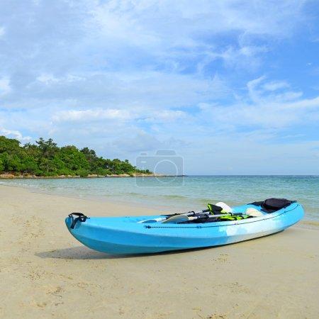Blue kayaks on the tropical beach