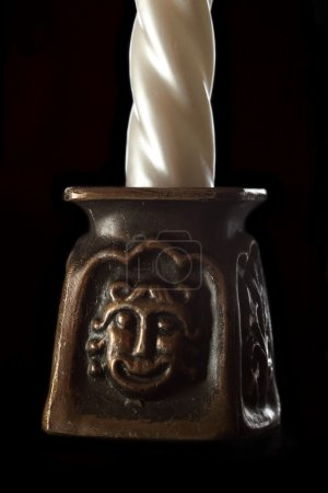 Ivory candle in candlestick