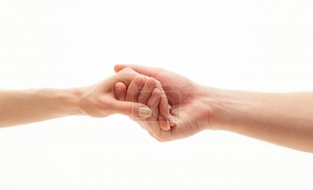Hands of man and woman holding together