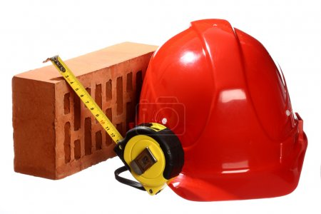 Brick, tape-line and helmet
