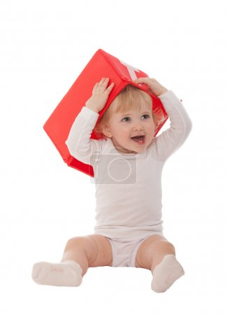 Happy baby girl with red box