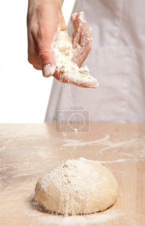 Woman's hand meals dough
