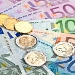 Euro money: closeup of banknotes and coins...