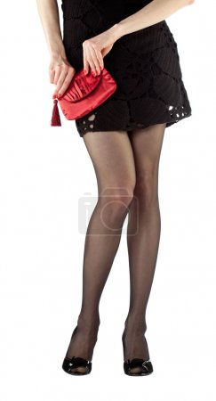 Beautiful young woman holding red handbag