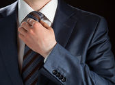 Businessman adjusting his tie