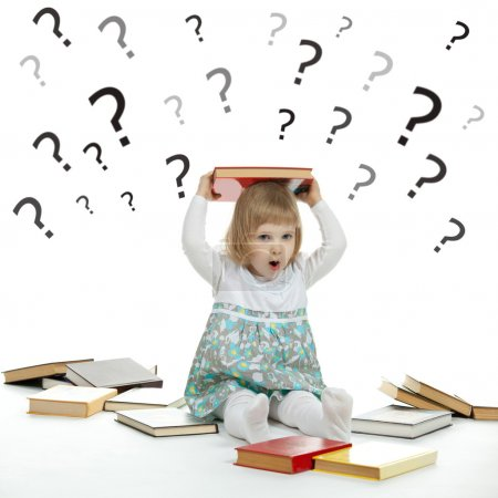 Little child surrounded by books and question marks