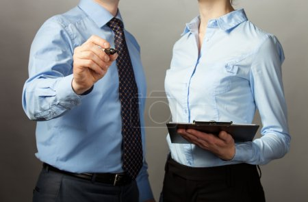 Businessman and businesswoman discussing a plan of work