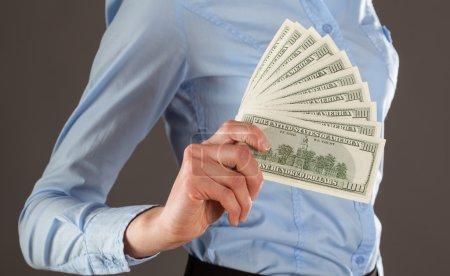 Woman's hand holding money