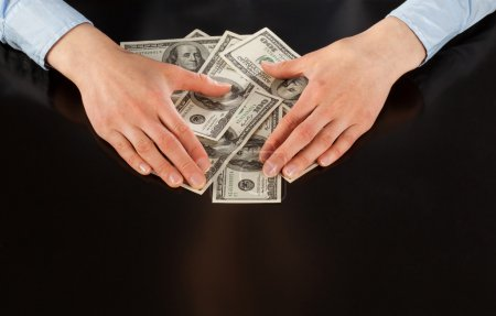 Hands and dollar banknotes
