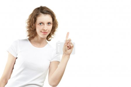 Young woman pointing at something, copyspace