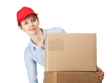 Smiling woman carrying big boxes