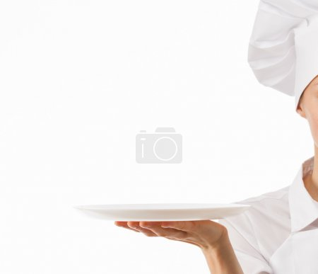 Chef cook holding white plate