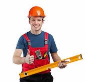 Fröhlich Bauarbeiter in uniform