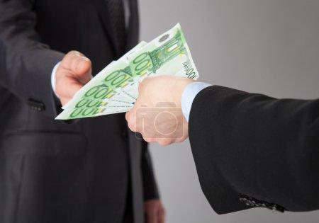 Businessman accepting money offer