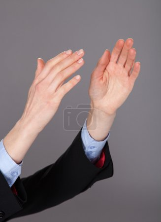 Closeup of human hands applauding