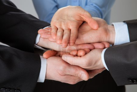 Joined hands of business people
