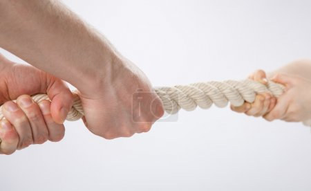 Hands pulling a rope