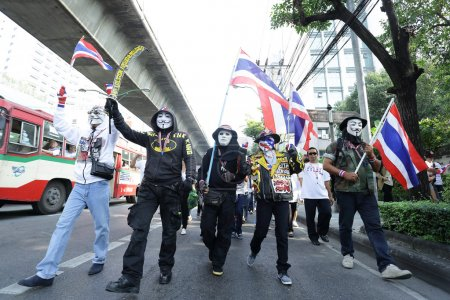 BANGKOK - DEC 9: Many Masked protesters walked for...