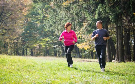 Seniors couple jogging in the park...