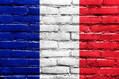 France Flag painted on brick wall