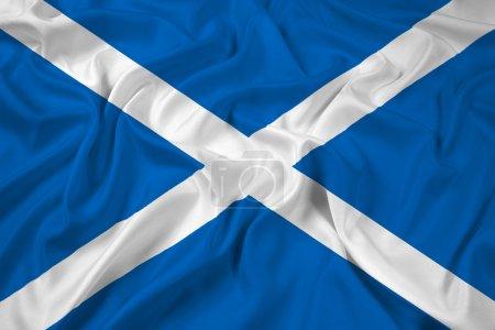 Photo pour Agitant le drapeau de l'Écosse - image libre de droit
