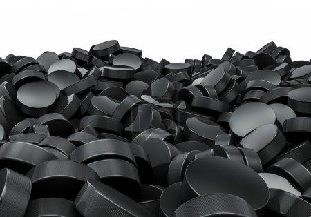 Hockey pucks pile