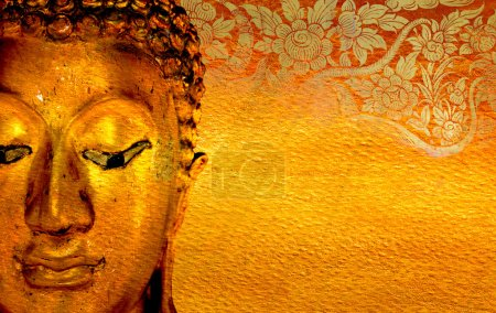 Buddha gold statue on golden background .