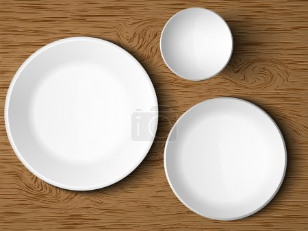 A set of white dishes on a wooden table