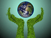 Caring for the environment arms out of the grass with a green globe The concept of ecology