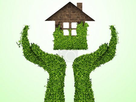 Caring for the environment, arms out of the grass with a green home. The concept of ecology
