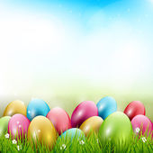 Easter background with colorful eggs in gras