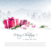 Christmas winter landscape with pink gift boxes and copyspac