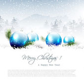 Christmas winter landscape with blue balls and copyspac
