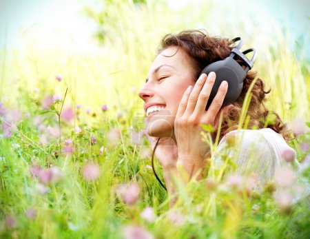 Photo for Beautiful Young Woman with Headphones Outdoors. Enjoying Music - Royalty Free Image