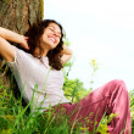 Beautiful Young Woman Relaxing outdoors. Naturev...