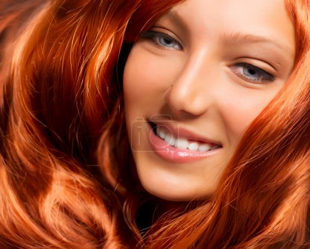 Hair. Beautiful Girl With Healthy Long Red Curly Hair